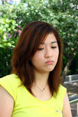 Asian woman with sad face — Stock Photo