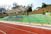 Stadium seats and running track — Stock Photo