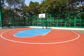 Basketball court in sunny day — Stock Photo