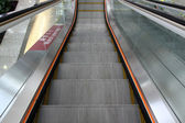 Abstract image of moving escalator — Stock Photo