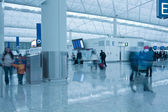 Moving in airport in blue toned — Stock Photo