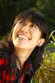 Asian woman smiling under sunshine — Stock Photo