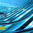 Moving escalator in modern interior, motion blurred. - Stock Photo