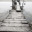 Stock Photo: Desolated wooden pier in low saturation