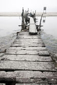 Desolated wooden pier in low saturation — Photo