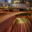 Traffic in modern city at night — Stock Photo #9396359