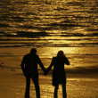 Couple at sunset - Stock Photo