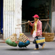Chinese woman hawker - Stock Photo