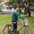 Stock Photo: Asian man riding bicycle