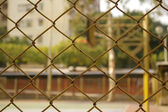 Basketball court through the net — Stock fotografie