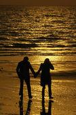 Couple at sunset — Stock Photo
