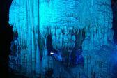 "Illuminated Yanzi Stalactite Caves displaying the ""Crystal Palac — Stock Photo"