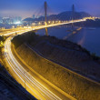 Ting Kau Bridge at night along the highway in Hong Kong - Stock Photo