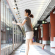 Running of a woman in rush hours on train station — Foto Stock