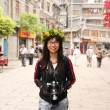 Asian woman travelling in China with her camera — Stock Photo