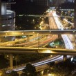 Stock Photo: Modern city with night traffic downtown