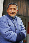 Old man in chinese village — Stock Photo