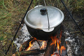 Cauldron on a campfire — Stockfoto