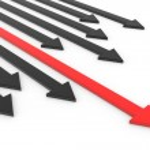 Red arrow ahead of black arrows. Concept of leadership, success — Stock Photo