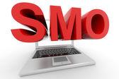 Ordinateur portable avec un mot de smo sur un screen.isolated sur fond blanc. — Photo