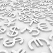 Currency signs on white surface. — Stock Photo