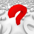 Stock Photo: Red 3d question mark among white question marks.