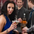Attractive woman sitting at the bar drink — Stock Photo