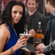 Attractive woman sitting at the bar drink — Stock Photo #10118663