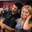 Attractive blond girl at cocktail bar smiling — Stock Photo