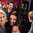 Girl friends at the bar hugging together — Stock Photo