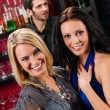Girl friends at the bar hugging together — Stock Photo #10118721