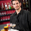 Professional barman cocktail bar hold serving tray — Stock Photo
