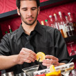 Stock Photo: Young bartender make cocktail prepare drinks