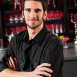 Barman wear black standing at cocktail bar — Stock Photo