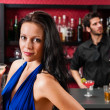 Glamour woman at bar holding cocktail - Foto de Stock