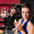 Glamour woman at bar holding cocktail — Stock Photo