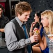 Happy friends at cocktail bar enjoy drinks — Stock Photo #10118775