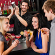 Royalty-Free Stock Photo: Barman cocktail shaker friends drinking at bar
