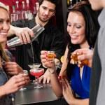 Barman cocktail shaker friends drinking at bar — Stock Photo