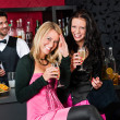 Happy girl friends with drinks enjoying party — Stok fotoğraf
