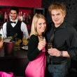 Stock Photo: Couple at cocktail bar drink champagne