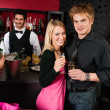 Couple at cocktail bar drink champagne — Stock Photo