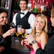 Stock Photo: Barman prepare cocktails friends drinking at bar