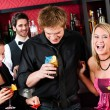 Friends at cocktail bar have party time - Stock Photo
