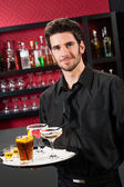 Professional barman cocktail bar hold serving tray — Stockfoto