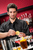 Young bartender make cocktail prepare drinks — Stock Photo