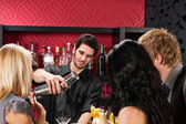 Barman prepare cocktail friends drinking at bar — Stock Photo