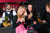 Happy girl friends with drinks enjoying party — Stock Photo