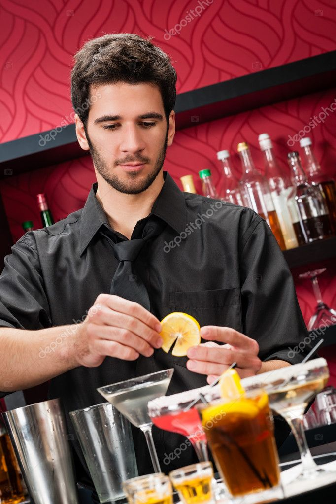 Handsome barman professional at posh bar making cocktail drinks — Stock Photo #10118749