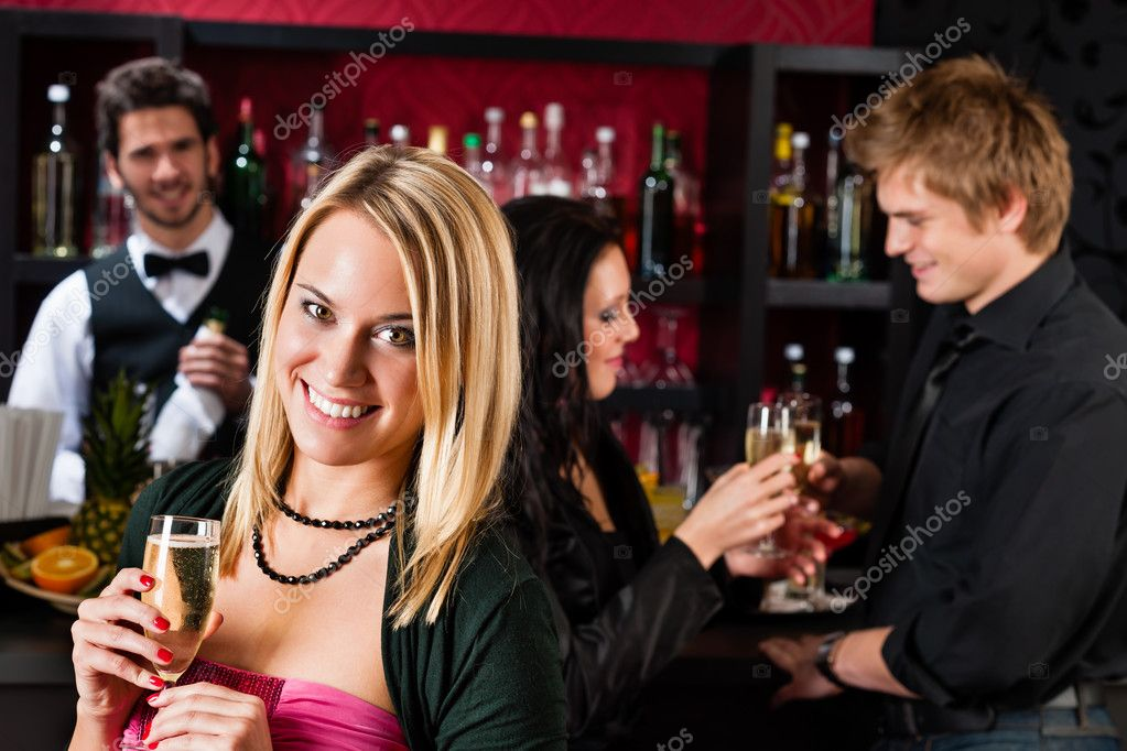 Attractive woman toast champagne with friends at cocktail bar — Stock Photo #10118844